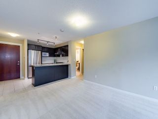 """Photo 2: 102 9199 TOMICKI Avenue in Richmond: West Cambie Condo for sale in """"MERIDIAN GATE"""" : MLS®# R2006928"""
