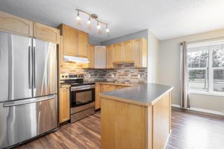 Main Photo: 1502 7171 Coach Hill Road SW in Calgary: Coach Hill Row/Townhouse for sale : MLS®# A1155862