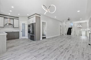 Photo 4: 13 TARALAKE Heath NE in Calgary: Taradale Detached for sale : MLS®# A1112672