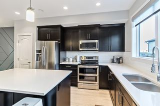 Photo 5: 1373 Legacy Circle SE in Calgary: Legacy Row/Townhouse for sale : MLS®# A1055779