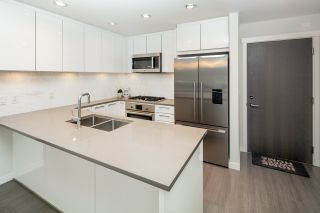 """Photo 2: 406 3263 PIERVIEW Crescent in Vancouver: South Marine Condo for sale in """"Rhythm"""" (Vancouver East)  : MLS®# R2480394"""