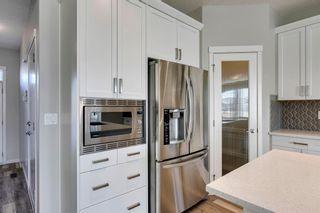 Photo 12: 209 Auburn Meadows Place SE in Calgary: Auburn Bay Semi Detached for sale : MLS®# A1072068