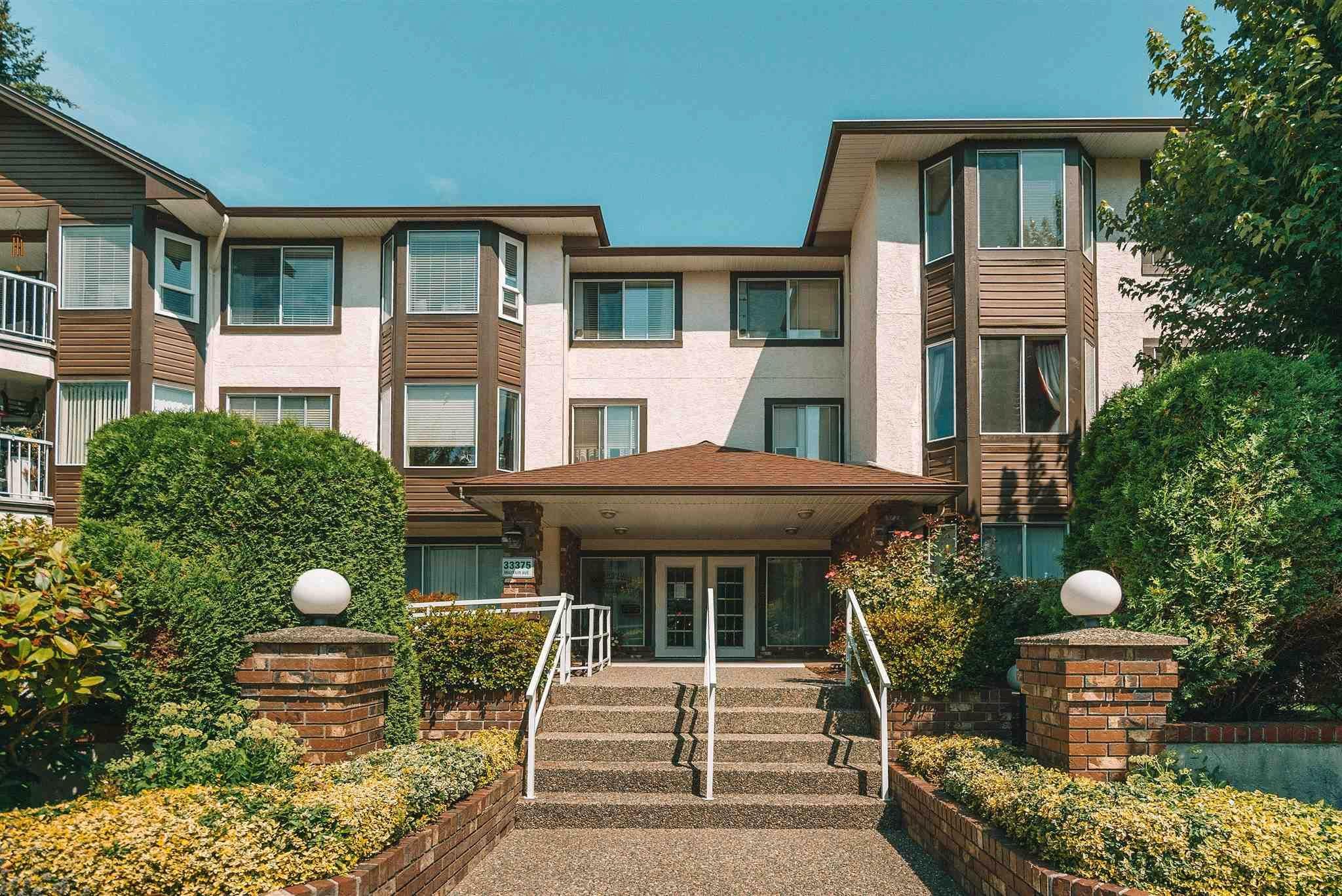 """Main Photo: 312 33375 MAYFAIR Avenue in Abbotsford: Central Abbotsford Condo for sale in """"MAYFAIR PLACE"""" : MLS®# R2604719"""