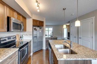 Photo 8: 33 Marine Drive SE in Calgary: Mahogany Row/Townhouse for sale : MLS®# A1124015