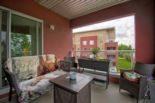 Photo 2: 2301 604 East Lake Boulevard NE: Airdrie Apartment for sale : MLS®# A1117760