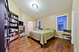 Photo 7: BRIDLEWOOD PL SW in Calgary: Bridlewood House for sale