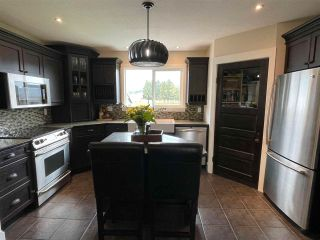 "Photo 2: 11154 MCSWEEN Road in Chilliwack: Fairfield Island House for sale in ""Fairfield Island"" : MLS®# R2572881"