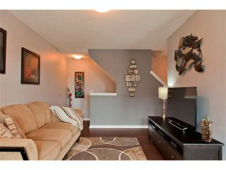 Photo 10: 100 WINDSTONE Mews SW: Airdrie House for sale : MLS®# C4055687