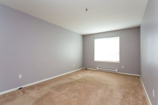 """Photo 12: 408 5465 201 Street in Langley: Langley City Condo for sale in """"Briarwood Park"""" : MLS®# R2393279"""