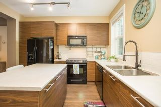 """Photo 2: 23 2495 DAVIES Avenue in Port Coquitlam: Central Pt Coquitlam Townhouse for sale in """"The Arbour"""" : MLS®# R2608413"""