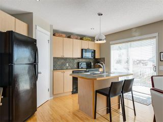Photo 10: 168 TUSCANY SPRINGS Circle NW in Calgary: Tuscany House for sale : MLS®# C4073789