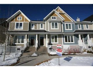 Photo 1: 32 MIKE RALPH Way SW in CALGARY: Garrison Green Townhouse for sale (Calgary)  : MLS®# C3557890