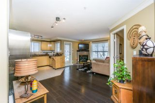 "Photo 1: 303 8115 121A Street in Surrey: Queen Mary Park Surrey Condo for sale in ""THE CROSSING"" : MLS®# R2137886"