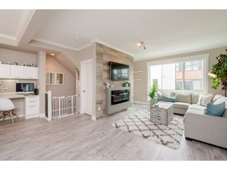"""Photo 3: 209 16488 64 Avenue in Surrey: Cloverdale BC Townhouse for sale in """"Harvest"""" (Cloverdale)  : MLS®# R2376091"""