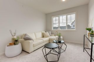 Photo 25: 249 Lucas Avenue NW in Calgary: Livingston Row/Townhouse for sale : MLS®# A1102463