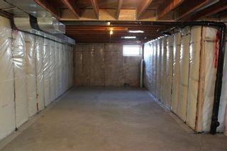Photo 39: 1014 Nanton Avenue: Crossfield Detached for sale : MLS®# C4281376