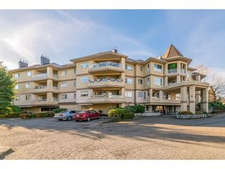 """Photo 1: 107 20120 56 Avenue in Langley: Langley City Condo for sale in """"Blackberry Lane 1"""" : MLS®# R2495624"""