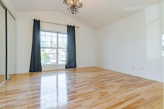Photo 12: 48 West Springs Way SW in Calgary: West Springs Row/Townhouse for sale : MLS®# A1148807