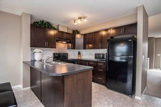 Photo 11: 53 105 DRAKE LANDING Common: Okotoks Row/Townhouse for sale : MLS®# C4257237