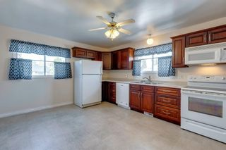 Photo 7: 302 Whitney Crescent SE in Calgary: Willow Park Detached for sale : MLS®# A1146432