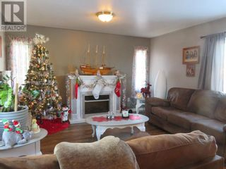 Photo 3: 8, 812 6 Avenue SW in Slave Lake: House for sale : MLS®# A1053665