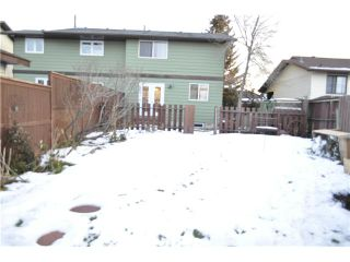 Photo 8: 557 SUMMERWOOD Place SE: Airdrie Residential Attached for sale : MLS®# C3592604