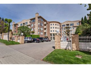 "Photo 1: 410 33731 MARSHALL Road in Abbotsford: Central Abbotsford Condo for sale in ""STEPHANIE PLACE"" : MLS®# R2573833"