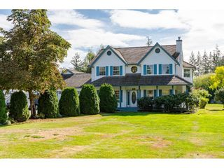"""Photo 1: 25120 57 Avenue in Langley: Salmon River House for sale in """"Strawberry Hills"""" : MLS®# R2500830"""