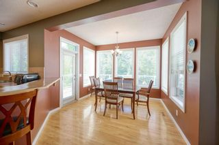 Photo 13: 323 Discovery Place SW in Calgary: Discovery Ridge Detached for sale : MLS®# A1141184