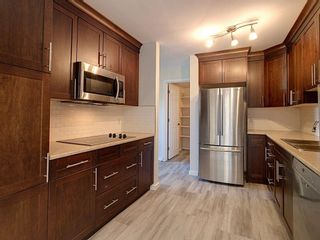 Photo 8: 4321 Riverbend Road in Edmonton: Zone 14 Townhouse for sale : MLS®# E4248105
