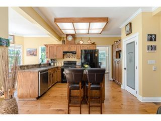 """Photo 5: 25120 57 Avenue in Langley: Salmon River House for sale in """"Strawberry Hills"""" : MLS®# R2500830"""