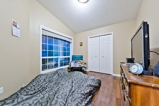 Photo 8: BRIDLEWOOD PL SW in Calgary: Bridlewood House for sale