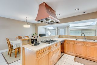 """Photo 12: 8217 WOODLAKE Court in Burnaby: Government Road House for sale in """"GOVERNMENT ROAD AREA"""" (Burnaby North)  : MLS®# R2159294"""