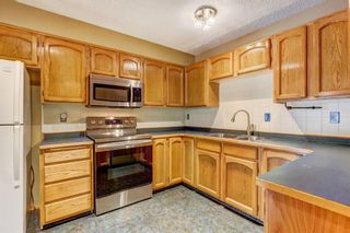 Photo 3: 820 Edgemont Road NW in Calgary: Edgemont Row/Townhouse for sale : MLS®# A1126146