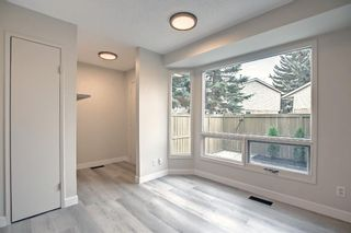 Photo 9: 77 123 Queensland Drive SE in Calgary: Queensland Row/Townhouse for sale : MLS®# A1145434