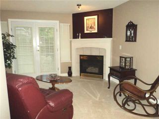 """Photo 2: 43 1255 RIVERSIDE Drive in Port Coquitlam: Riverwood Townhouse for sale in """"RIVERWOOD GREEN"""" : MLS®# V901232"""