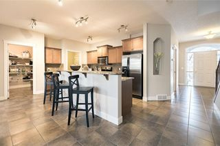 Photo 8: 210 VALLEY WOODS Place NW in Calgary: Valley Ridge House for sale : MLS®# C4163167