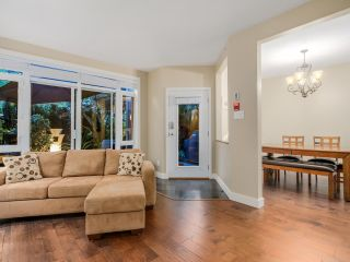 """Photo 3: 108 3600 WINDCREST Drive in North Vancouver: Roche Point Townhouse for sale in """"WINDSONG AT RAVEN WOODS"""" : MLS®# R2067772"""