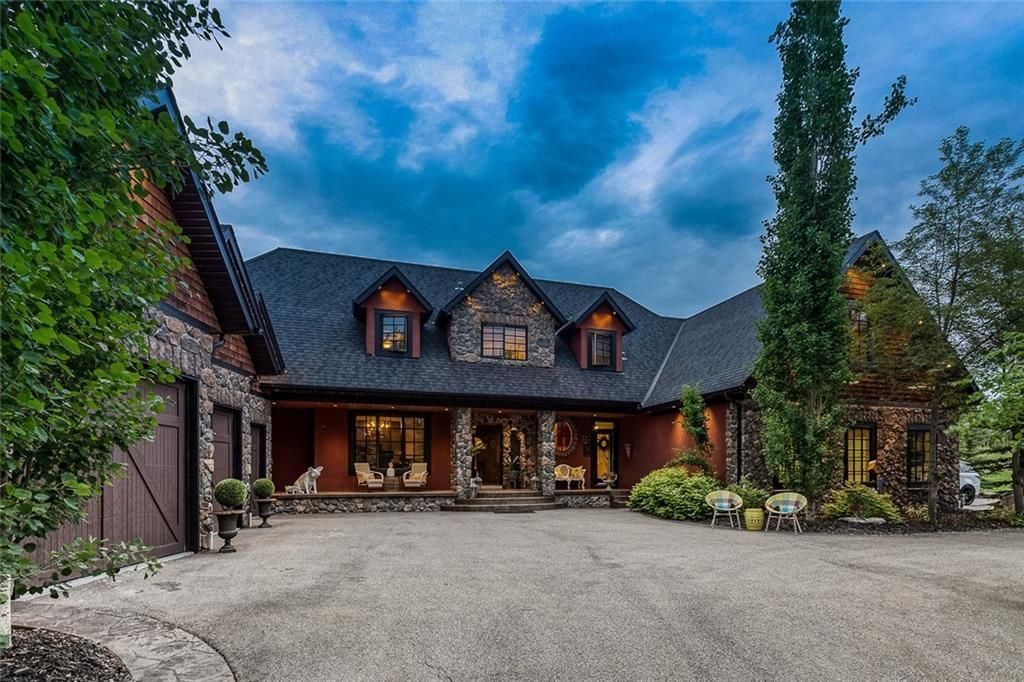 Main Photo: 16 Woodland Rise in Rural Rocky View County: Rural Rocky View MD Detached for sale : MLS®# A1048056