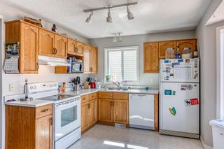 Photo 6: 38 Coverdale Way NE in Calgary: Coventry Hills Detached for sale : MLS®# A1120881