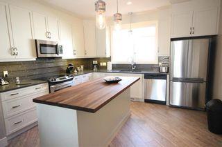 Photo 4: 10604/06/08 61 Avenue in Edmonton: Zone 15 House Triplex for sale : MLS®# E4225377