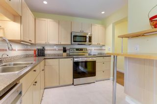 """Photo 11: 205 33401 MAYFAIR Avenue in Abbotsford: Central Abbotsford Condo for sale in """"MAYFAIR GARDENS"""" : MLS®# R2611471"""