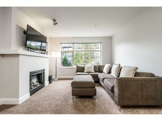 Photo 2: 203 400 KLAHANIE DRIVE in Port Moody: Port Moody Centre Condo for sale : MLS®# R2411778