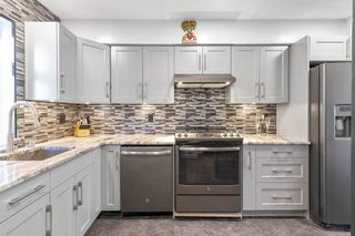 "Photo 2: 104 1570 PRAIRIE Avenue in Port Coquitlam: Glenwood PQ Townhouse for sale in ""Violas"" : MLS®# R2567923"