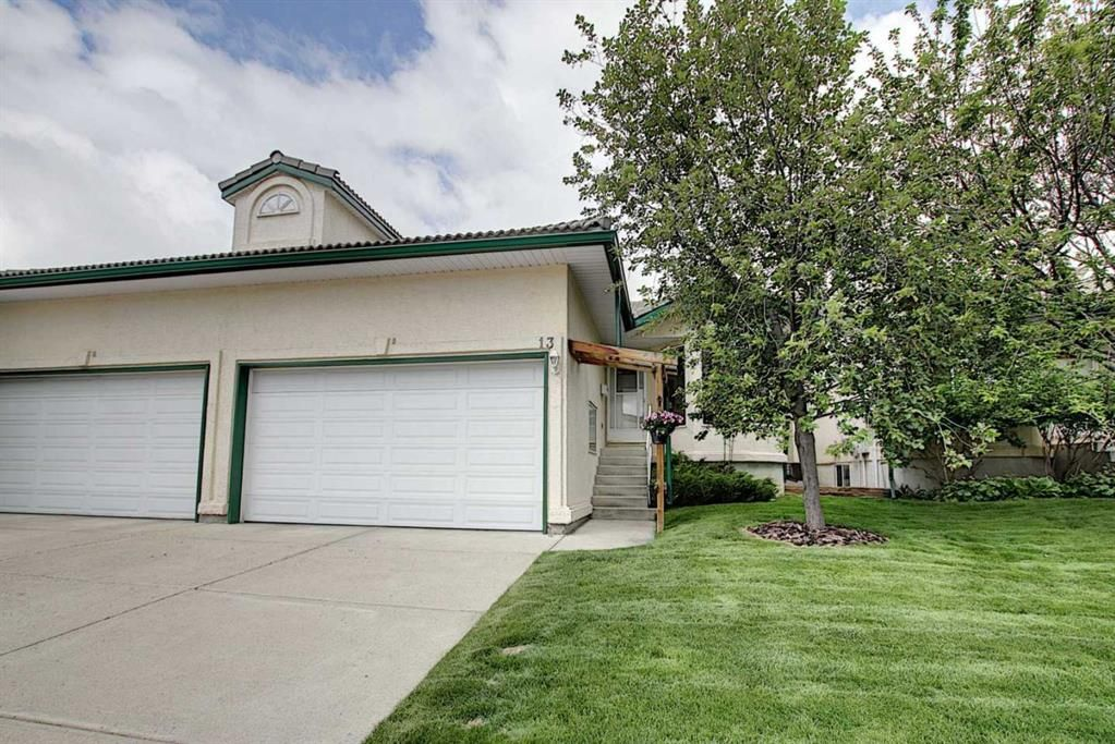Main Photo: 13 Strathearn Gardens SW in Calgary: Strathcona Park Semi Detached for sale : MLS®# A1114770