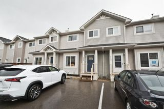 Photo 3: 511 Strathaven Mews: Strathmore Row/Townhouse for sale : MLS®# A1118719