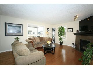 Photo 4: 1857 BAYWATER Street SW: Airdrie House for sale : MLS®# C4104542