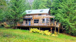 Photo 1: Keats Island-10 acres with a cabin and two bunkhouses for sale