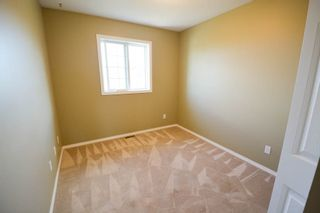Photo 8: 7921 88 Avenue in Fort St. John: 1/2 Duplex for sale