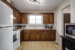 Photo 10: 8347 CENTRE Street NW in Calgary: Beddington Heights House for sale
